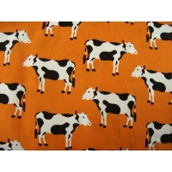 tissu coton imprimé vache orange,150 cm, de très belle qualité