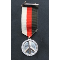 broche medaille