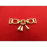 accessoire de décoration doré,  à appliquer sur un tee shirt ou pour customiser un sac , un blouson ....